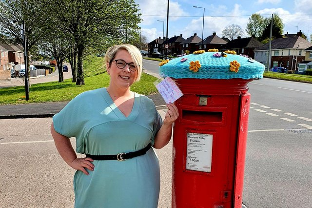 Louise Green from Sheffield is pictured with her postbox topper.