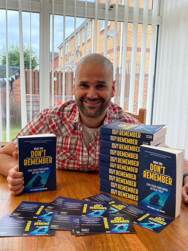 Former teacher Steve Johnson at home in Rotherham with physical copies of his co-authored debut novel.