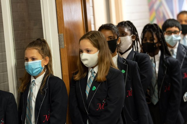 Year eight pupils wear face masks as a precaution against the transmission of the novel coronavirus  (Photo by OLI SCARFF / AFP) (Photo by OLI SCARFF/AFP via Getty Images)
