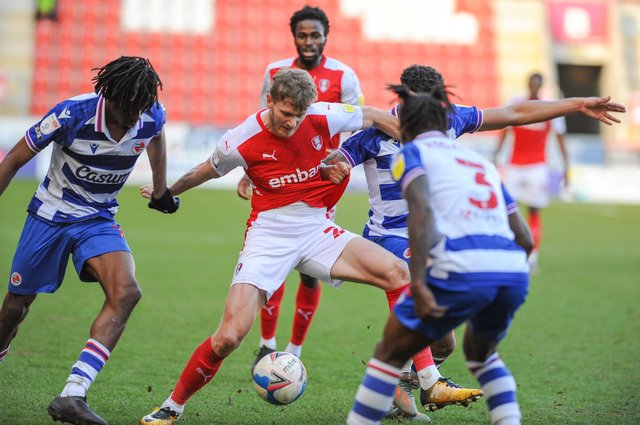 Rotherham United's Michael Smith tries to find a path through Reading during their Championship match at the New Yorks Stadium on Saturday