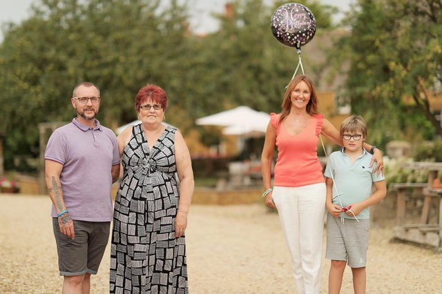 Pictured: Amanda Village (3rd right) with her son Kai (4th right), found birth mother Sue (2nd right) and her found brother Trevor (1st -on far left) Picture: WallToWall