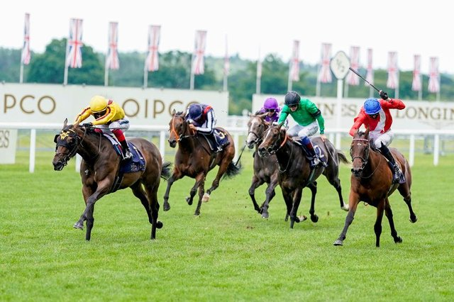 Campanelle, left, on the way to victory in last year's Queen Mary Stakes at Royal Ascot. Photo by ALAN CROWHURST/POOL/AFP via Getty Images