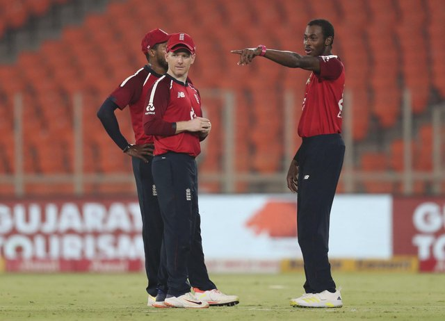 Jofra Archer, right, will miss England one-day series against India due to a recurring elbow injury. (AP Photo/Ajit Solanki)