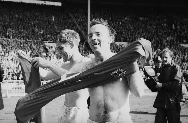 Teammates Alan Ball, left, and Nobby Stiles celebrate after England's victory in the 1966 World Cup final at Wembley, 30th July 1966. (Photo by Evening Standard/Hulton Archive/Getty Images)