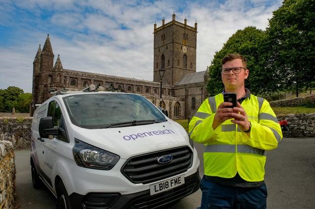 Engineer in front of van with phone