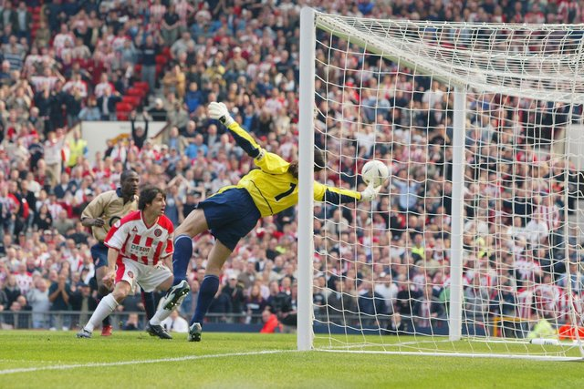 David Seaman of Arsenal makes a spectacular save to keep Paul Peschisolido's header out in the FA Cup semi-final against Sheffield United at Old Trafford (Photo by Laurence Griffiths/Getty Images)