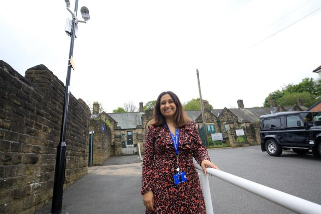 Headteacher Hannan Mohammed beneath the new CCTV cameras installed at Carfield Primary School in Meersbrook, Sheffield, to stop drivers parking dangerously close to the school gates (pic: Chris Etchells)