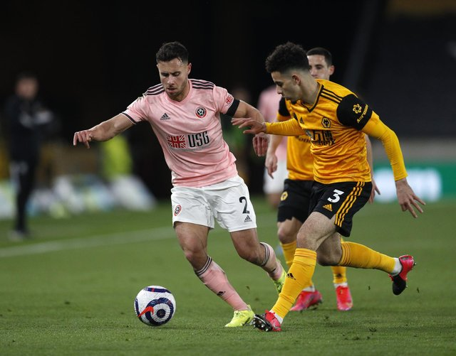 Wolverhampton, England, 17th April 2021. Rayan Ait-Nouri of Wolverhampton Wanderers with George Baldock of Sheffield Utd during the Premier League match at Molineux, Wolverhampton. Picture credit should read: Darren Staples/ Sportimage