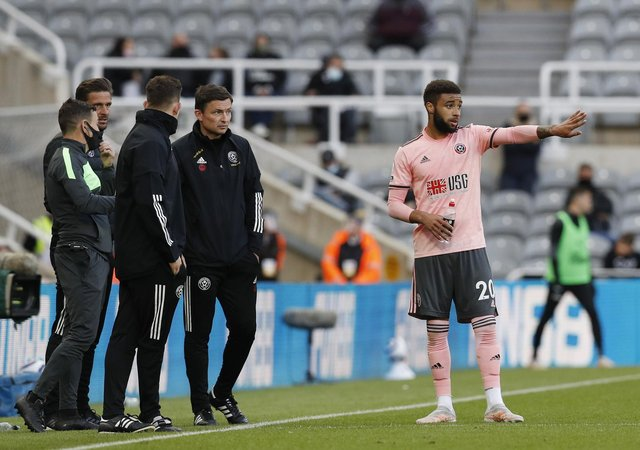 Newcastle, England, 19th May 2021. Jayden Bogle of Sheffield Utd receives instructions from Paul Heckingbottom interim manager of Sheffield Utd during the Premier League match at St. James's Park, Newcastle. Picture credit should read: Darren Staples / Sportimage