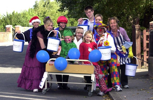 Which Docaster care home staff can you spot in these retro pictures? This snap shows the 2003 Bed pushers, the Millennium Volunteers and helpers,  who set off from Goldthorpe on their sponsored bed push to raise money for Sue Ryder Care at Hickleton Hall. On the bed are, from left, Emily White, aged eight, Emily Notman, aged 13, and Lucy Turner, aged seven. Pushing are, from left, John Twiggs, aged 22, Sarah Dixon, aged 18, Sarah Bradley, aged 25, Peter Kidd, aged 17, Amy Wright, aged 25, acting care centre manager Wendy Eliot (c), aged 45. and Millenium Volunteers co-ordinator Diane Cadman, aged 50.