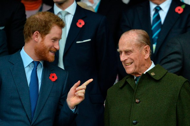 Britain's Prince Harry (L) speaks with his grandfather Prince Philip  (Photo by GLYN KIRK / AFP) (Photo by GLYN KIRK/AFP via Getty Images)