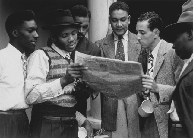 Remember Windrush hoped to share stories and experiences from Sheffield's Windrush generation.  Picture from 22nd June 1948 of Jamaicans reading a newspaper whilst on board the ex-troopship 'Empire Windrush' bound for Tilbury docks in Essex.  (Photo by Douglas Miller/Keystone/Getty Images)