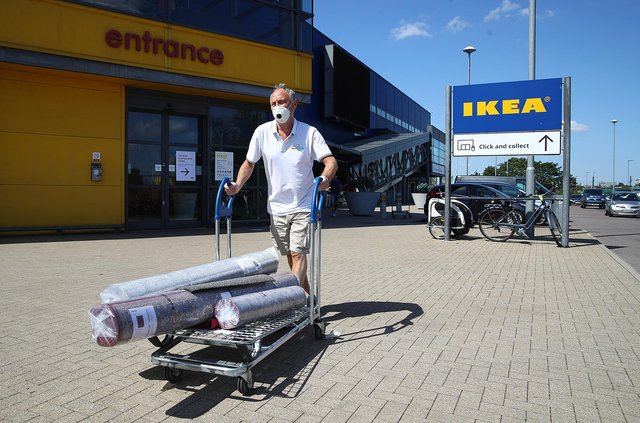 A man leaves with his goods after shopping at Ikea. Picture: Julian Finney/Getty Images.