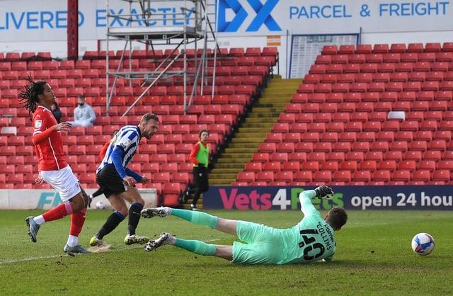 Jordan Rhodes of Sheffield Wednesday scores against Barnsley at Oakwell.