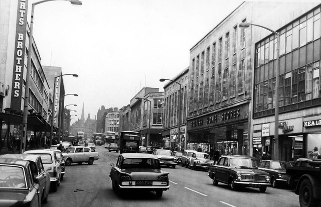 The Moor, Sheffield, showing Robert Brothers Department Store, Rockingham House, British Home Stores and Pauldens, February 1966