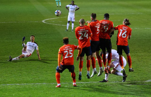 Lewis Wing of Rotherham United slips as he takes a freekick during the Sky Bet Championship match between Luton Town and Rotherham United at Kenilworth Road.  (Photo by Richard Heathcote/Getty Images)