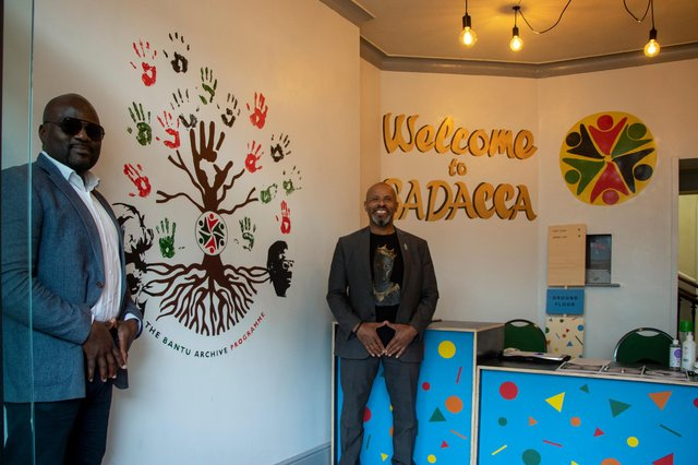 Olivier Tsemo and Robert Cotterell pictured beside the Bantu Archive Programme mural.