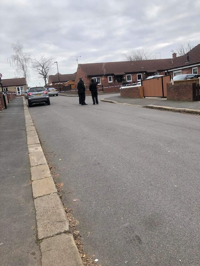 Ashpool Close is cordoned off by police following the shootings
