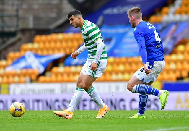 Mohamed  Elyounoussi of Celtic takes on Jamie McCart of St. Johnstone (Mark Runnacles/Getty Images)