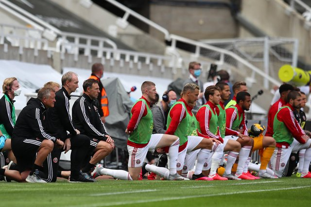 Chris Wilder and his players and staff take a knee: Simon Bellis/Sportimage