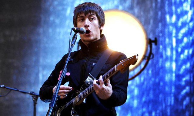 Arctic Monkeys lead singer Alex Turner performing at T in the Park festival, in Balado, Perth and Kinross. A guitar belonging to Arctic Monkeys frontman Alex Turner has raised £128,54 in a charity raffle for grassroots music venues.