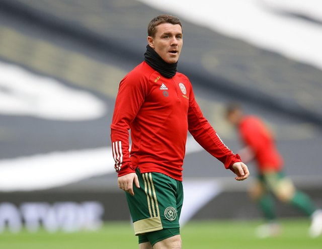 Sheffield United midfielder John Fleck has tested positive for Covid-19 while on international duty with Scotland