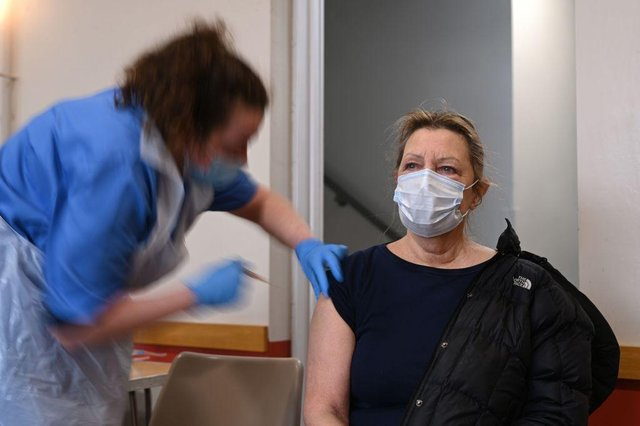 A patient is vaccinated at St Columba's church in Sheffield (Photo by OLI SCARFF/AFP via Getty Images)