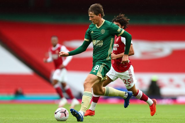 Sheffield United's Norwegian midfielder Sander Berge runs with the ball during the English Premier League football match between Arsenal and Sheffield United at the Emirates Stadium in London on October 4, 2020. (Photo by Clive Rose / POOL / AFP)