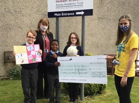 Lower Meadow Academy handing a cheque to a Sheffield Children's Hospital representative.