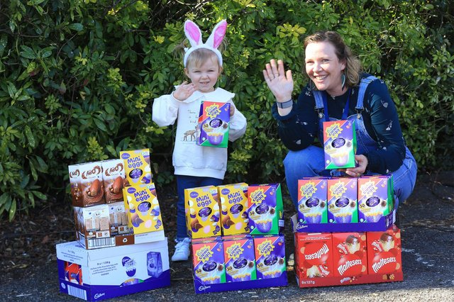 Alice Cleverley is almost 3yrs old and was worried that some boys and girls wouldn't get Easter eggs. So with the help of her mum Lauren Swann she had made bracelets and sold them to raise money for Baby Basics Sheffield. Alice is pictured with Cat Ross CEO of Baby Basics. Picture: Chris Etchells