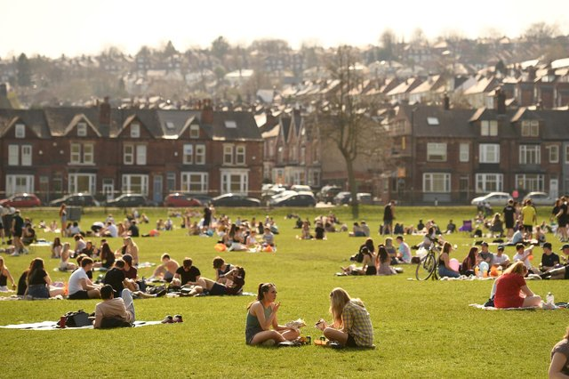 People enjoy the sunshine in Endcliffe Park in Sheffield . (Photo by Oli SCARFF / AFP) (Photo by OLI SCARFF/AFP via Getty Images)