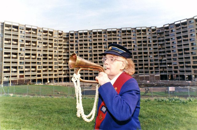 Resident Marion Day certainly wasn't sad to see the back of Kelvin Flats as she played the last post when they were demolished on March 10, 1995