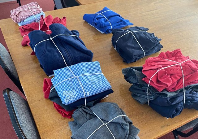 Uniform Items bundled up and ready to go. Picture by Ecclesfield Parish Council
