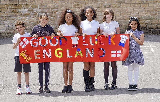 Pupils from Malin bridge Primary School show their support for England in Euro 2020. Connor Hanson, Maggie Pulleng, Sasha Lewin,Robyn Lewin, Gracie Walsh and Anisah Khan.  Picture Scott Merrylees