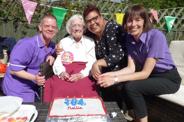 Nellie Alker with the Grange Crescent team on her 104th birthday.