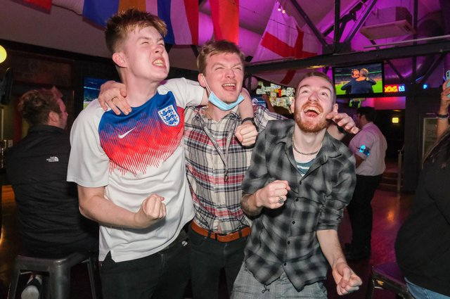 England fans celebrate while watching the Euro 2020 semi-final in The Common Room in Sheffield