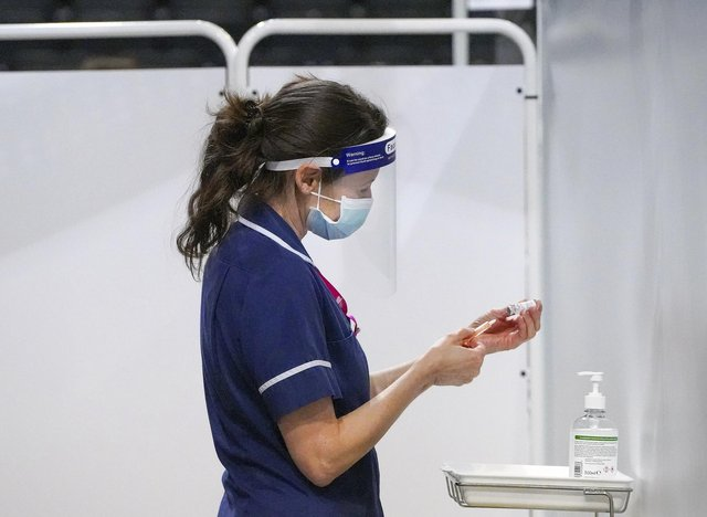 A nurse at a Covid 19 mass-vaccination centre. Picture Scott Merrylees