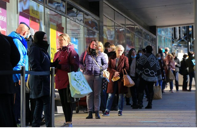 Debenhams store on The Moor sees a long queue of shoppers waiting outside its premises before it opens for the first time in months. Picture by Chris Etchells