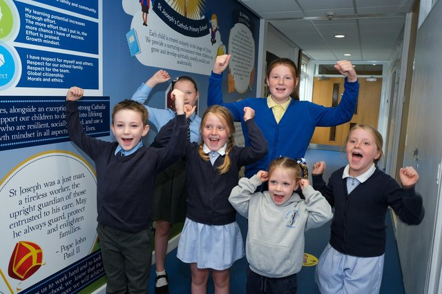 Pupils at St joseph's in Dinnington celebrate their much improved OFSTED report