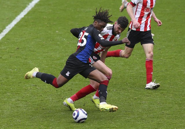Crystal Palace's Eberechi Eze scores his side's second goal against Sheffield United. (AP Photo/Alex Livesey, Pool)