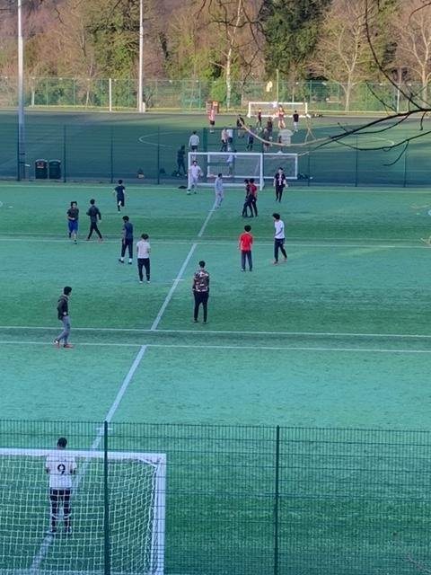 Trespassers flouting lockdown rules by gathering to play football at the University of Sheffield's Goodwin Sports Centre (pic: Glyn Watson)