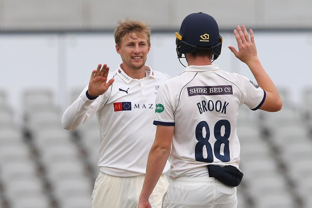 Joe Root of Yorkshire celebrates with Harry Brook after taking a wicket  (Photo by Alex Livesey/Getty Images)
