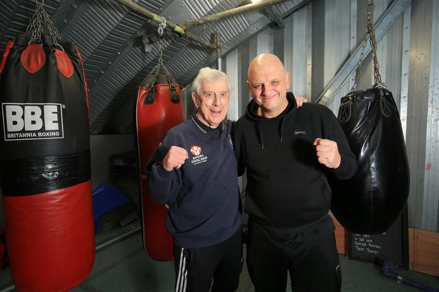 Alwyn pictured with Robert Riley, who runs Riley's boxing & fitness centre.