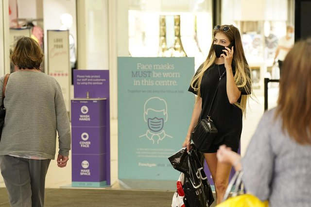 Shoppers alongside Covid instruction signs in Frenchgate Shopping Centre, Doncaster, during the easing of lockdown restrictions in England. Picture date: Monday June 14, 2021.