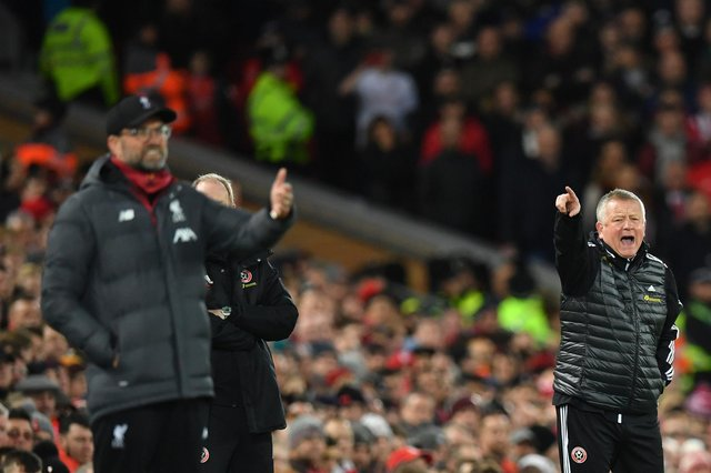 Liverpool's Jurgen Klopp and his Sheffield United counterpart Chris Wilder will go head-to-head at Bramall Lane on Sunday.  (Photo by PAUL ELLIS/AFP via Getty Images)