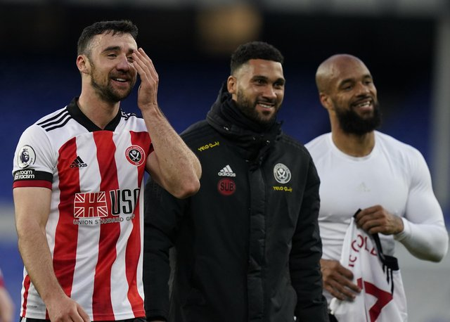 Liverpool, England, 16th May 2021. Enda Stevens Wes Foderingham and David McGoldrick of Sheffield Utd walk off smiling after winning 1-0  during the Premier League match at Goodison Park, Liverpool. Picture credit should read: Andrew Yates / Sportimage