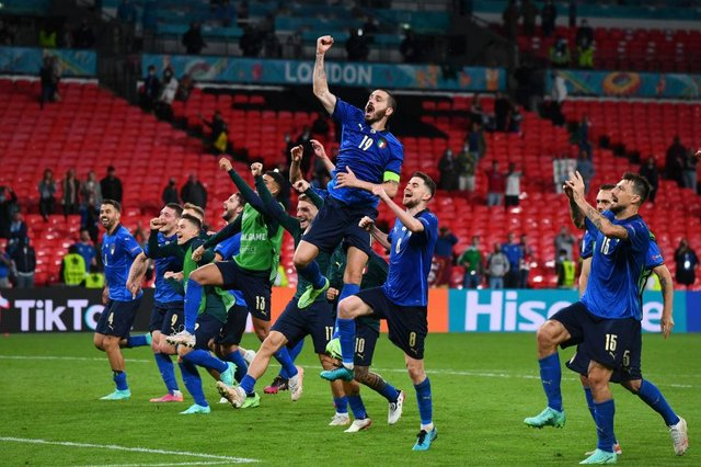 Italy celebrate their victory over Austria. Photo by Claudio Villa/Getty Images