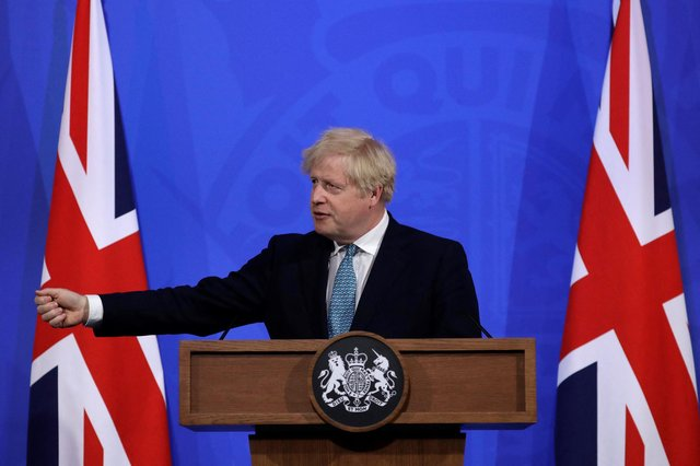Britain's Prime Minister Boris Johnson gives an update on the coronavirus Covid-19 pandemic . (Photo by Matt Dunham / POOL / AFP) (Photo by MATT DUNHAM/POOL/AFP via Getty Images)