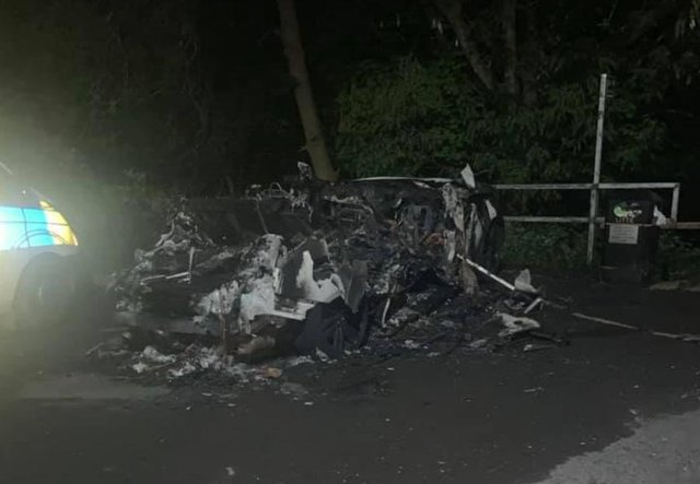 The wreckage of a car which went up in flames on Reaper Crescent in High Green, Sheffield