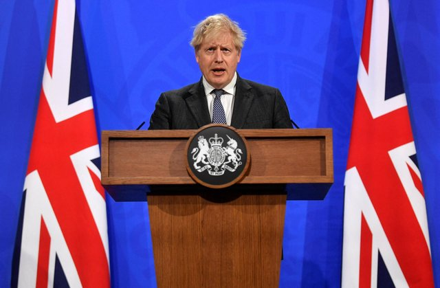 Britain's Prime Minister Boris Johnson (Photo by TOBY MELVILLE/POOL/AFP via Getty Images)
